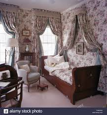 floral wallpaper and drapes with co ordinating linen and on sleigh