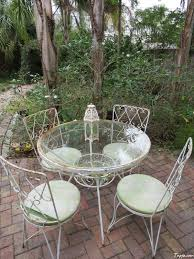 simple decorating backyards ideas with round glass table and metal