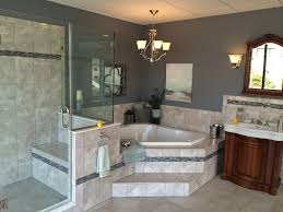 traditional master bathroom with corian counters u0026 stone tile