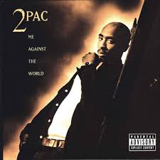 celebrating the 20 year anniversary of 2pac s all eyez on me tupac stands slanted against a wall a look of serious thought on his face he is dressed conservatively and the watch on his wrist is the only piece of