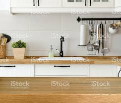 wooden table with kitchen counter and sink background stock photo