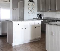 can white laminate cabinets be painted a year in review of how i painted my laminate cabinets with