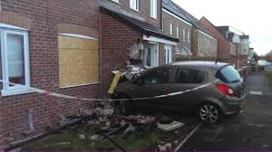 car crashes into garden wall and house in ashington bbc news