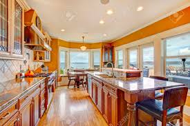 yellow and white themes bright kitchen with hardwood floor wood