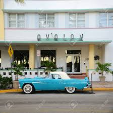 1957 ford thunderbird in front of art deco style avalon hotel