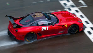 ferrari back ferrari 599xx evo red back rain race finish ferrari red race track