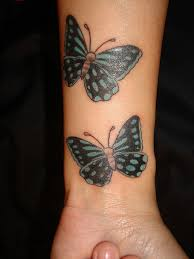 two black butterflies wrist tattoos ideas pictures