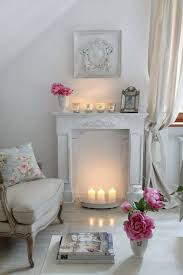 decorative fireplace mood with candles and lanterns