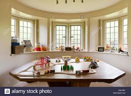 toy train set on a large table in a children play room stock photo