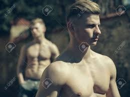 haircut for long torso young man sexy muscular bodybuilder macho with bare torso stylish