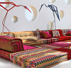 colorful modular sofa featuring colorful fabric area rug and white