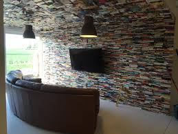 i attached 4000 books to my new living room wall and ceiling