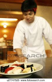japanese restaurant cook at table stock image of waiter cleaning table at japanese restaurant