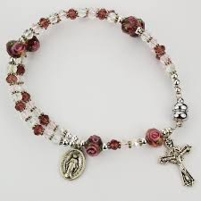 purple rosary purple magnetic rosary bracelet the catholic company