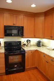 cherry wood cabinets new venetian gold granite countertops black