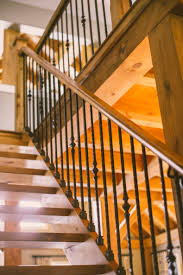 dark oak staircase with wrought iron pickets and square posts