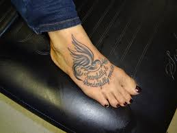 girly black and grey bird tattoo on a foot by by kmgsucks on
