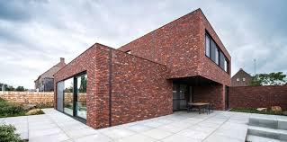 prachtig huis met dynamiek in volumes en top gevelsteen