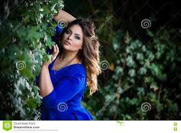 young beautiful caucasian plus size model in blue dress outdoors