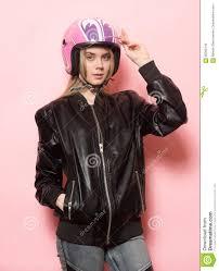 pink motorcycle jacket biker wearing black leather jacket and pink motorcycle helmet