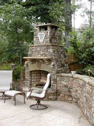 Patio Fireplace Kit by Decksouth Stone Outdoor Fireplace With Retaining Wall Decksouth