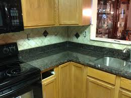 granite kitchen backsplash donna s brown granite kitchen countertop w travertine