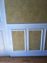 use chair rail molding and picture frames with wallpaper on top