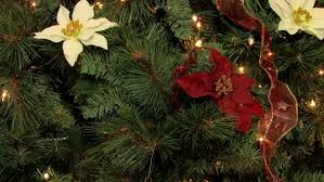 christmas tree flower lights christmas tree decorated with lights balls flowers ribbons and