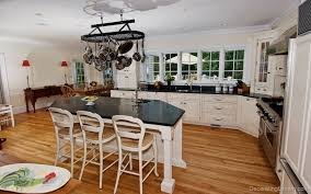 kitchen island with pull out table tile floors candlelight kitchen cabinets convection electric