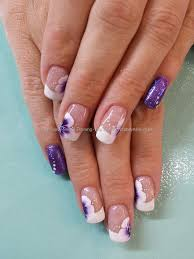 purple glitter with white french tips and one stroke flower nail