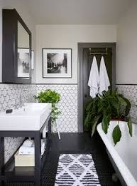 fleur de lis bathroom decor ideas on flipboard 9 gorgeously graphic bathrooms courtesy of instagram black grout