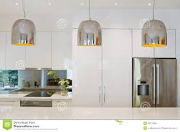 luxury home kitchen island with hanging lights stock photos