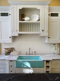 bathroom floating gray trough sink with graff faucets and merola