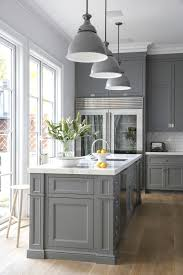 grey colored kitchen cabinets with white appliances home furniture