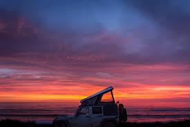 jeep wrangler beach sunset angola awaits the road chose me