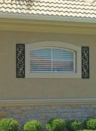 the european look faux wrought iron shutters two 14 x 41 1 2