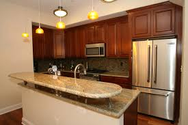decorating charming wood flooring with white kitchen cabinet by