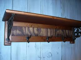 furniture wall coat rack with shelf and black hook hanging on