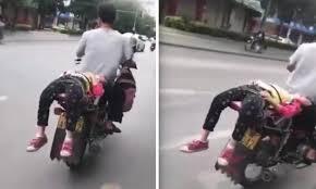 si e moto enfant il attache sa fille à sa moto parce qu refuse d aller à l école