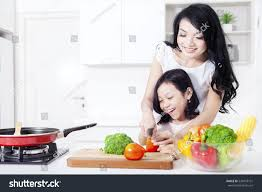 beautiful mother teaches her cute stock photo 524918101