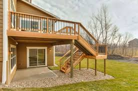 wooden deck with staircase and landing deck staircase design