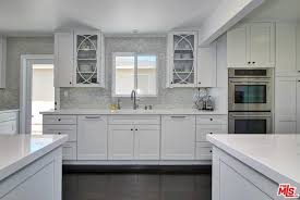 kraftmaid kitchen island traditional kitchen with one wall glass panel in culver city ca