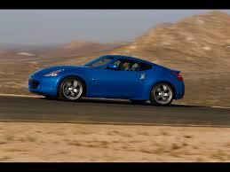 nissan 370z wallpaper 2009 nissan 370z blue side angle speed 1024x768 wallpaper