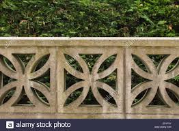 garden wall built from decorative concrete blocks stock photo