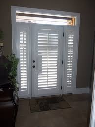 brown fabric french door window treatments in a luxurious