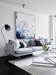 small living dining room ideas living room pale grey sofa scatter cushions pastel painting