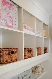 take 2 bookshelves and turn them into a built in wall unit hometalk