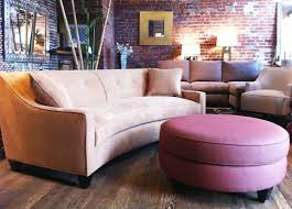 furniture curved sectional sofas with pink ottoman round table on