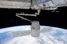 spacex dragon docked to space station nasa