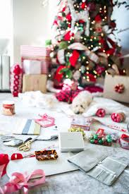gift wrapping under the christmas tree the sweetest thing